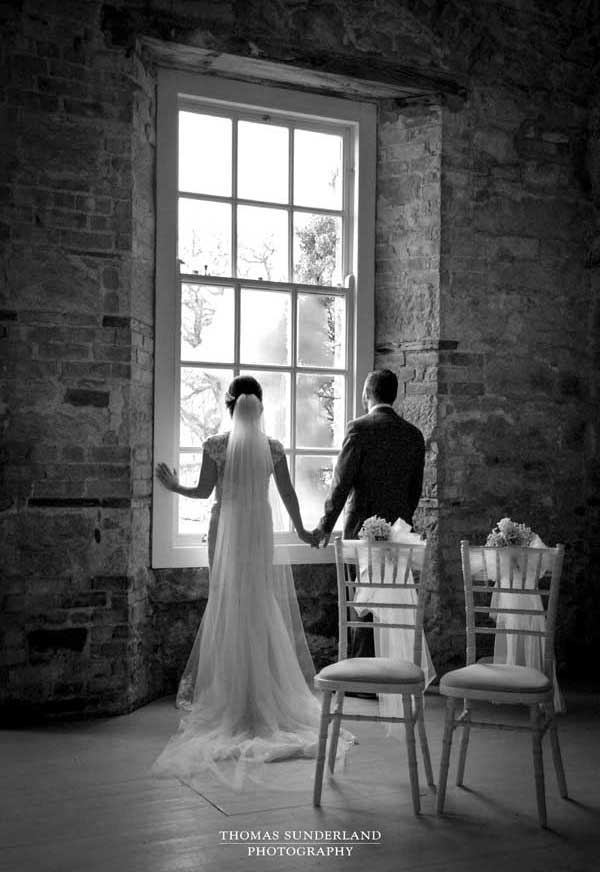Thomas Sunderland Photography Bride and Groom by window