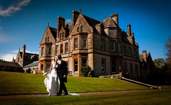Castle-Leslie-Estate-Couple-outside-Castle-high-res-Slider