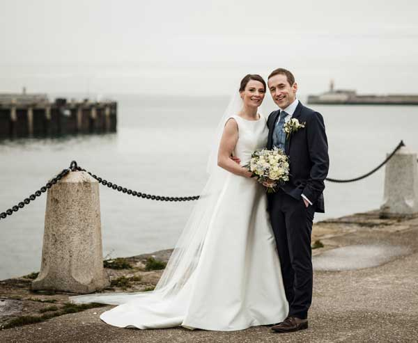 Solweg & Conor Real Wedding in the Royal Marine Hotel Couple by the pier