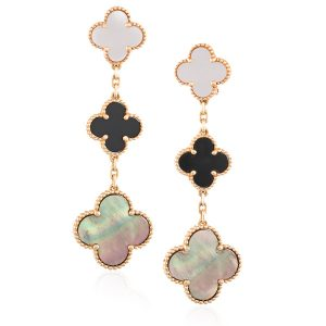 Lot 5: A PAIR OF MOTHER-OF-PEARL AND ONYX 'MAGIC ALHAMBRA' PENDENT EARRINGS, BY VAN CLEEF & ARPELS Estimate €4,000 - €5,000